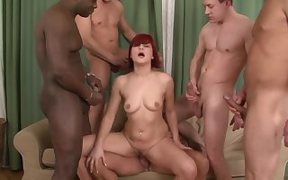 Redhead clumsy Lucy Uneasiness takes a loto f dicks all over the brush holes